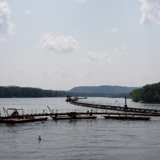 The pipes are float on barges along the river and are flexible.